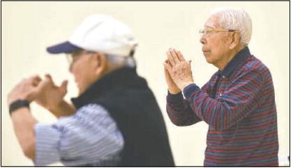 Quarter century later, founder of  Qigong class is still going strong